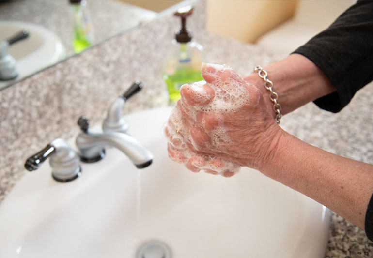 Washing your hands with soap and water.